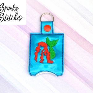 Ariel hand sanitizer holder key fob in the hoop embroidery file by spunky stiches