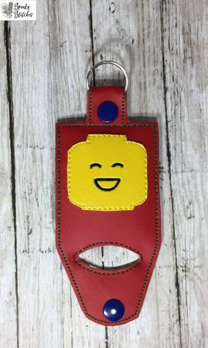 lego hand sanitizer holder key fob in the hoop embroidery file by spunky stitches