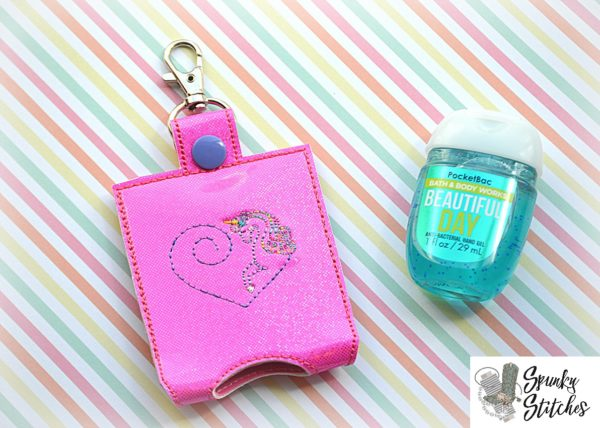 Unicorn sanitizer holder key fob in the hoop embroidery file by spunky stitches.