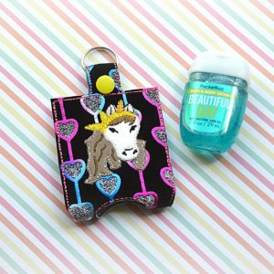 Unicorn with bandana sanitizer holder key fob in the hoop embroidery file by spunky stitches.