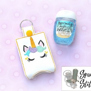 Sleepy unicorn face Hand sanitizer holder key fob in the hoop embroidery design by spunky stitches