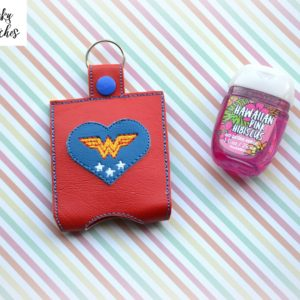 Wonder woman Hand sanitizer holder key fob in the hoop embroidery design by spunky stitches