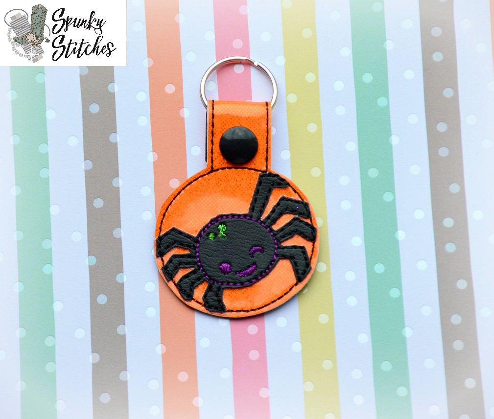 spider key fob in the hoop embroidery file by spunky stitches
