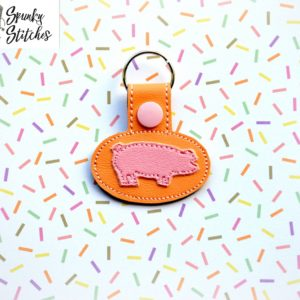 pig key fob in the hoop embroidery file by spunky stitches