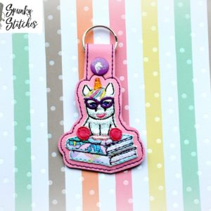 nerdy unicorn on books key fob in the hoop embroidery file by spunky stitches