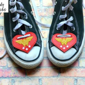 wonder woman shoe lace tags in the hoop embroidery file by spunky stitches