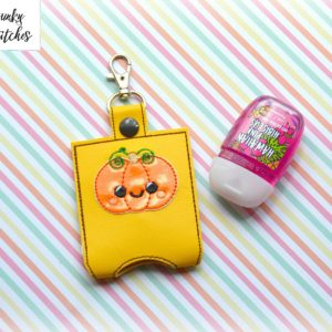 cute pumpkin hand sanitizer holder key fob in the hoop embroidery file by spunky stitches