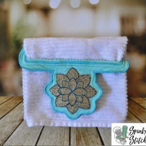Flower towel holder in the hoop embroidery file by spunky stitches