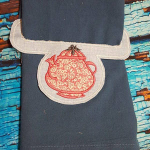 Teapot towel holder in the hoop embroidery file by spunky stitches