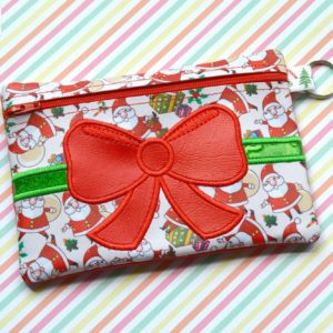 Bow zipper bag in the hoop embroidery file by spunky stitches