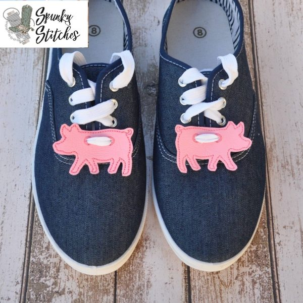 pig shoe tags in the hoop embroidery file by spunky stitches