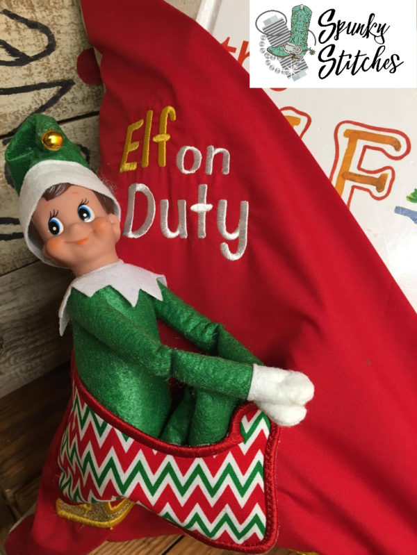 Elf on Duty Reading Pillow in the hoop embroidery file by spunky stitches