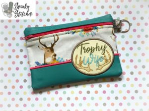 Trohy wife zipper bag in the hoop embroidery file by spunky stitches