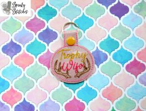 Trophy wife key fob in the hoop embroidery file by spunky stitches