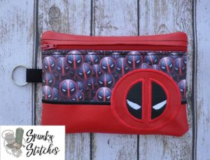 Deadpool zipper bag in the hoop embroidery file by spunky stitches