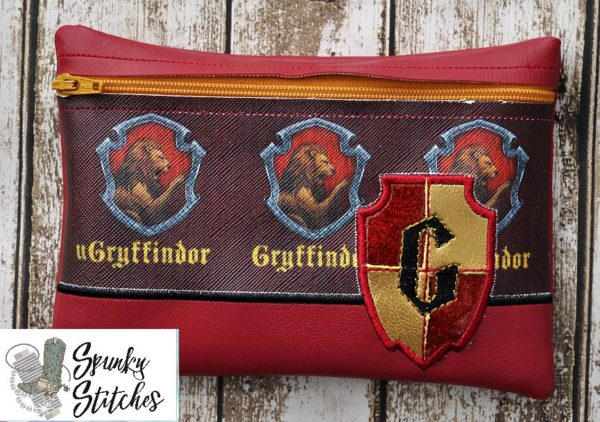 Gryffindor zipper bag in the hoop embroidery file by spunky stitches