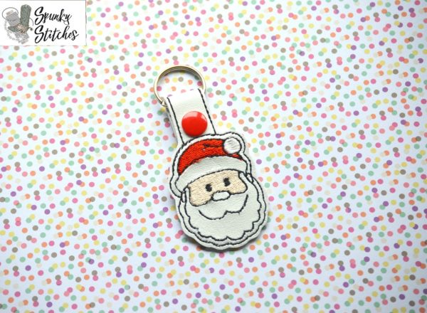 santa key fob in the hoop embroidery file by spunky stitches