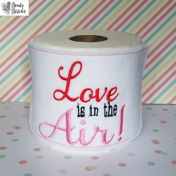 love is in the air toilet paper holder in the hoop embroidery file by spunky stitches