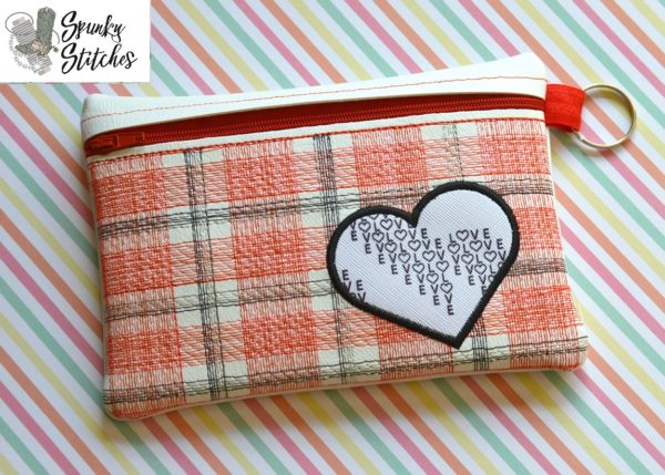 plaid heart zipper bag in the hoop embroidery file by spunky stitches.