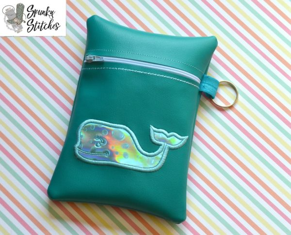 whale zipper bag in the hoop embroidery file by spunky stitches.