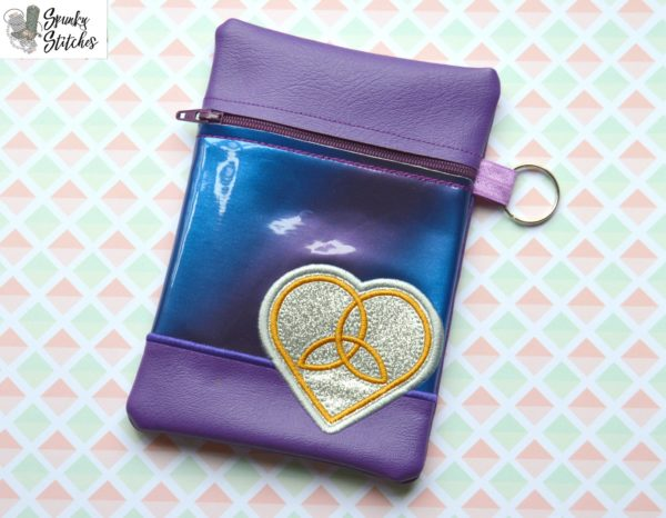 Celtic Heart zipper bag in the hoop embroidery file by Spunky stitches