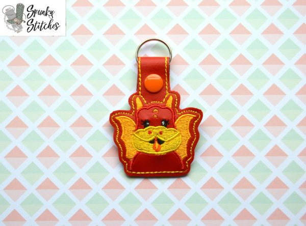 Dragon Key Fob in the hoop embroidery file by Spunky stitches
